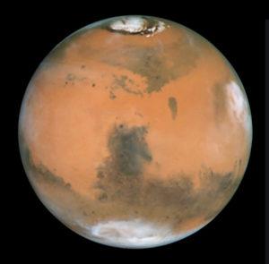 Mars mit Syrtis Major, aufgenommen mit dem HST. Quelle: NASA, ESA