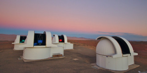 The four telescopes of the SPECULOOS Sounthern Observatory, ready for the night